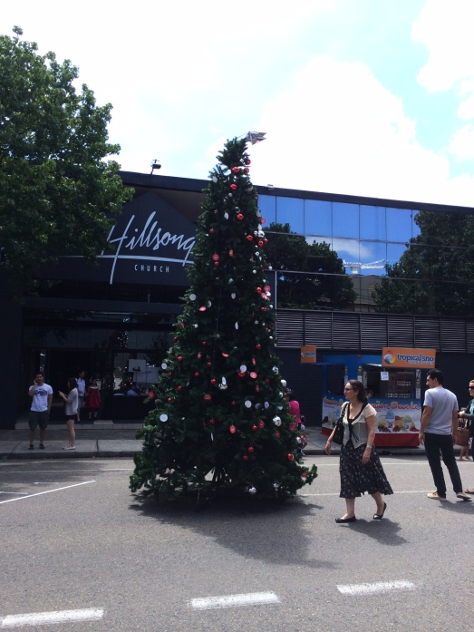 An outdoor Christmas tree in the midst of a street festival by the Hillsong Church in our neighbourhood